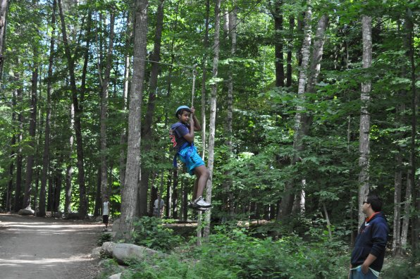 M.J. Denaris cruises down the zip line next to the super-cool ropes course.