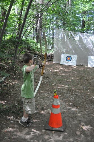 Tate Sheehan takes aim at the target (and the offered reward of a handful of Cheez-Its).