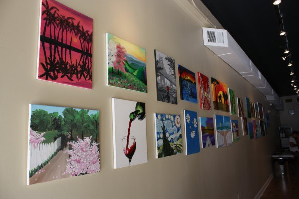 A sampling of some of the paintings offered at Cork and Canvas.