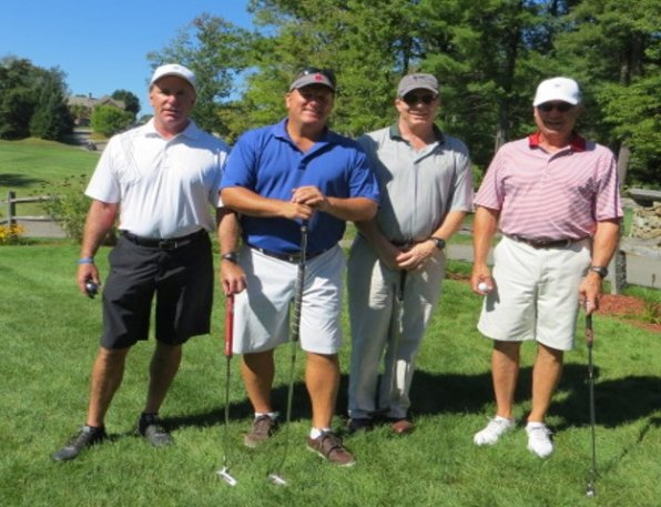 Defending champs in the house! That's the team to beat, the Rowley Agency foursome. And they'll be playing at the Friends Program tourney again to defend their title. Team members are Rob Simpson, Gary LaPierre, Bruce Langley and Mark Douglas.