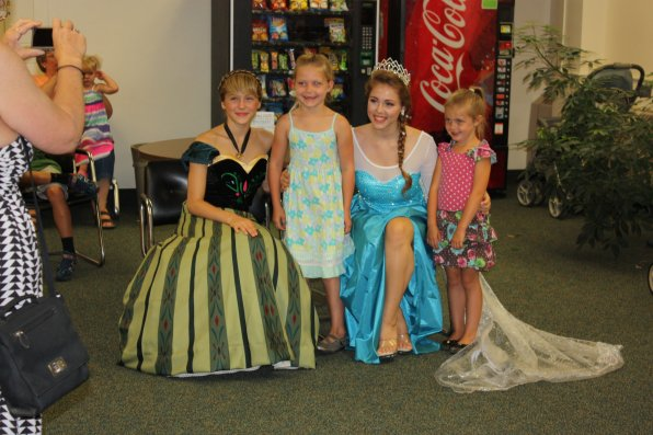 """Brittnee Matott (second from left), 6, and her sister Amber (right), 5, both of Concord, have their picture taken with Emilee (left) and Brooke Mills dressed up as """"Frozen"""" princesses Anna and Elsa."""