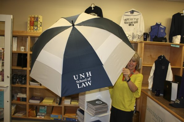 Donna Garofoli shows off the latest in functional fashion at the bookstore. She must have had to run a clearance sale when the school officially changed its name from the Franklin Pierce Law Center last August. Make it rain, Donna!