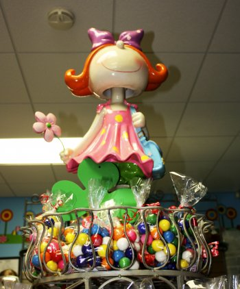 "<strong>Penny Candy Shop</strong></p><p>Our motto for 2012: ""Treat yo' self!"" So, a visit to the Penny Candy Shop was mandatory. The store owner's name is indeed Penny, but there's more to the shop than just the name. In fact, there's an antique gumball machine that dispenses candy for merely one cent!<br />We're more of a chocolate and peanut butter crowd, ourselves, and we didn't hesitate to sink our teeth into one (or two) of their handmade peanut butter cups."