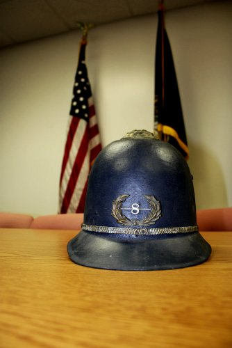 An authentic bobby-style helmet worn by a turn-of-the-century patrolman.