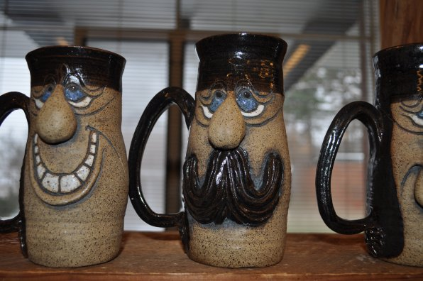 Expressive mugs made by Jean Reynolds of Concord.