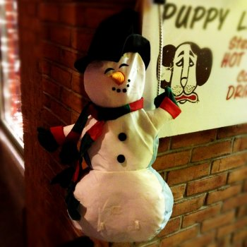 A cute snowman adorns Puppy Love.
