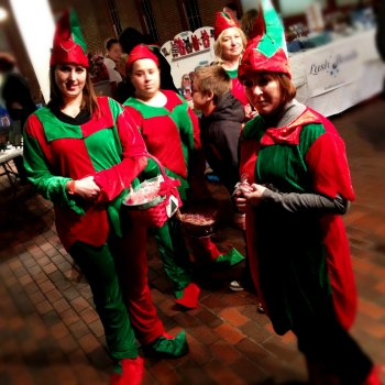 A cadre of elves await  the throngs of gift-crazed children.