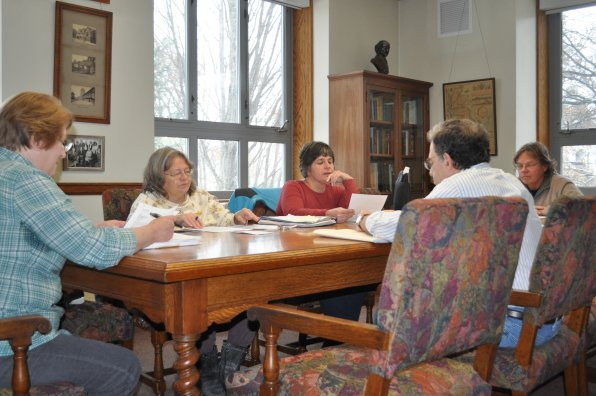 Concord Writers Group members Barbara Lassonde, Chris Weeden, Judy Boucher-Leidner, Brian Phelps and Paul Levy discuss a query letter written by Levy in the Shakespeare Room of the Concord Public Library. Old William would be proud!
