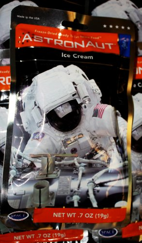 Plenty of food and water should be a given. When it comes to food, you're going want something that will last for a long time – no perishables. We found this dehydrated astronaut ice cream at the McAuliffe-Shepard Discovery Center gift shop. They also had plenty of dehydrated astronaut water lying around – just add water! (Okay, those may have been cups.)