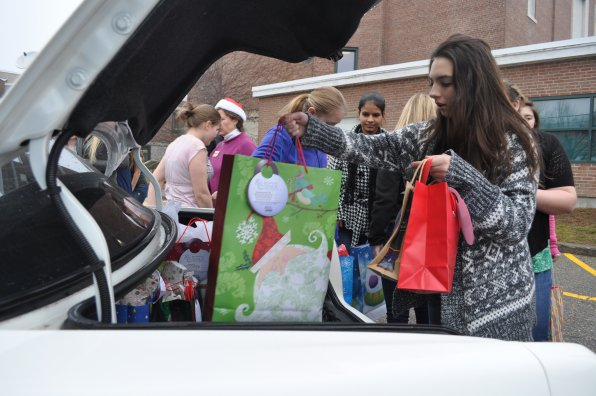 Sabrina Duquette helps load up Hayes's sleigh.