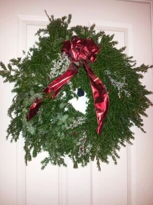 One of Trevor's wreaths adorns a door.