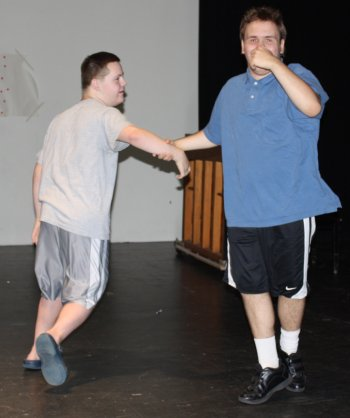 "Steven Gould and Matthew Audet shook their tail feathers during ""The Chicken Dance."""