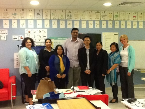 Cheri McManus and Dianne Melim with the Lexicon Reading Center staff in Dubai.