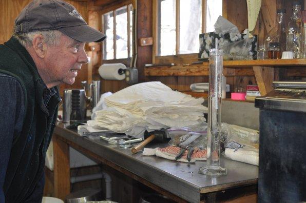 Wilber checks the sugar content of the sap at his sugar shack.
