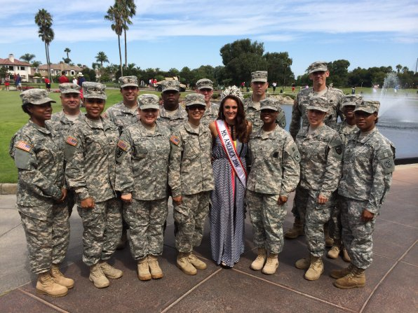 Dr. Stephanie Mills of Crossroads Chiropractic was named Ms. America 2014 last month, and then she joined the military! Well, not for good, just for a visit and this photo. She'll be making plenty of appearances during the year!