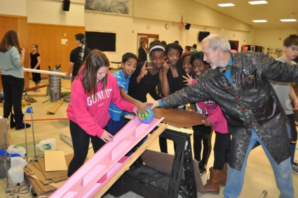 Izzi Laflamme, Ghana Darjee, Rachel Kikuni, Roselyn Kapper, Bobbyline Bargblor and Dekontee Harmon get ready to test it out with science teacher Chris Lane.