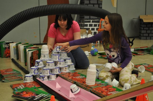Joslyn Harris and Willow Folsom build the yogurt cup structure.