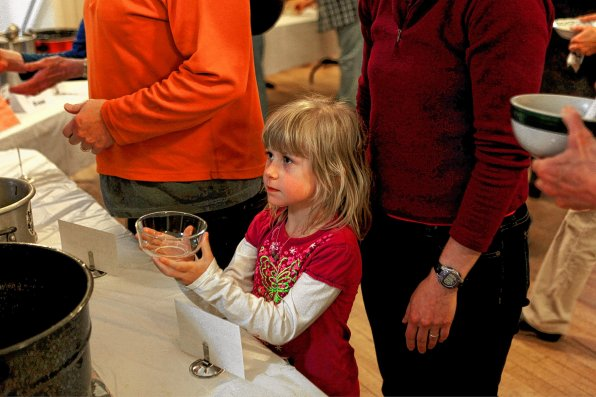 Brynna Streeter, 5, waits for a nice bowl of matzo ball soup at last year's SoupFest at South Congregational Church. This year's festivities will be held at Rundlett Middle School, and is now called Souperfest.
