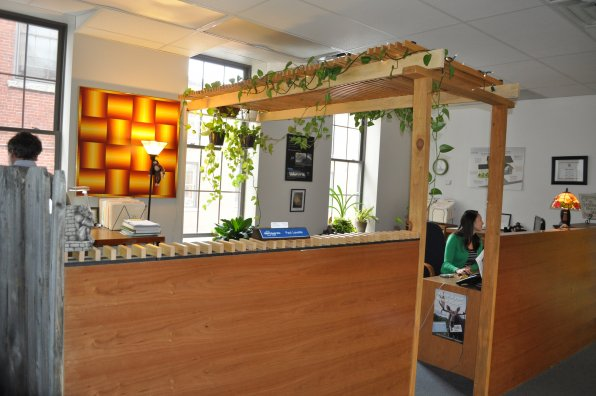 <strong>The Jordan Institute and Resilient Buildings Group</strong></p><p>The Jordan Institute and Resilient Buildings Group moved to their new location on Dixon Avenue less than two years ago and immediately added some of their signature efficient touches. To create separation between the workspace and a hallway for people traffic, Resilient Building Group staffers Paul Leveille and Alison Keay – both of whom have architecture backgrounds –  built a cubicle-type setting out of repurposed wood, complete with hanging greenery. None of the wood pieces are affixed to the building, so no structural changes needed to be made, and it all blends together to create a peaceful environment. They also each have a standing desk in their workspace, as does executive director of the Jordan Institute, Laura Richardson.