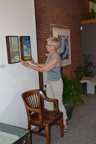 Owner Sarah Chaffee makes sure things look just right for the 35th anniversary show.