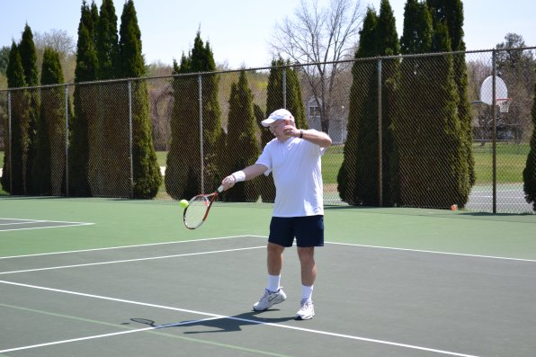 Lee Sturtevant, founder of the Capital City Tennis Network, takes a couple practice swings before an arranged match at Merrill Park. If you join the network, you could be on the other side of the net.