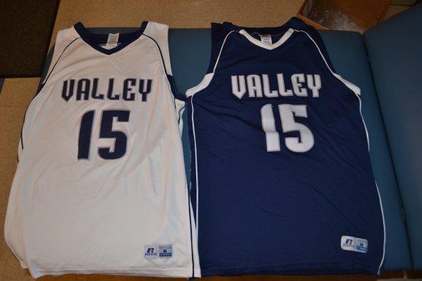The old unis being passed down the junior varsity teams.