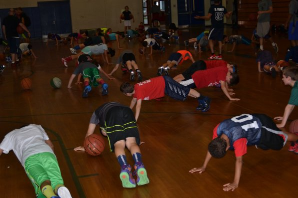 Listening is strongly encouraged at Bonner's camp, like don't dribble when you're not supposed to. And when it happens, push-ups for everybody.
