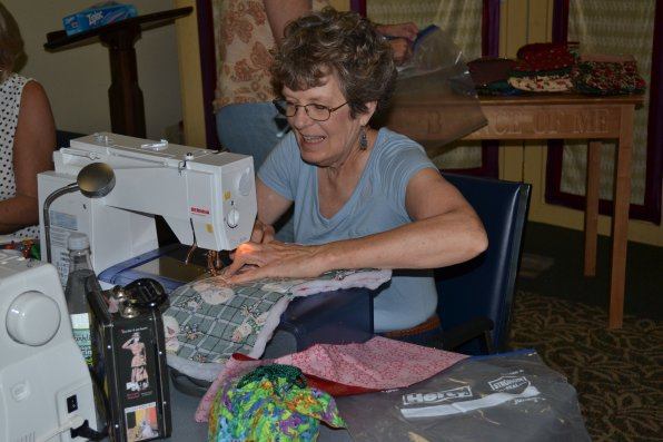 Martha Eilers gets to stitching her snowman stocking.