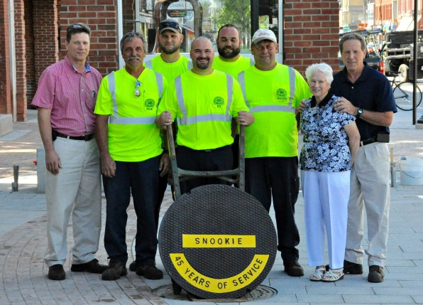 Members of the Concord sewer crew presented the refurbished manhole cover in honor of Snookie Emmons to members of Snookie's family last month, before placing it in Eagle Square for posterity. Looking good, old Snook!