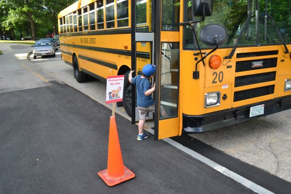 Gabe Hutchinson, 6, isn't quite sure if getting on a school bus before the start of school is actually a good idea.