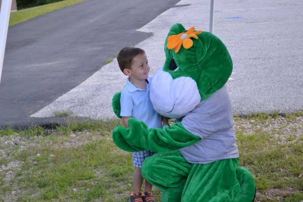 Hayden Greene, 4, gets a hug from Bowgie, the Bow Parks and Recreation Department's mascot.