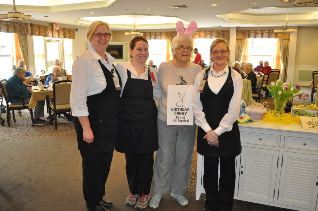 "Ruth ""Bunny"" Dodge turned 96 years young Friday afternoon, and celebrated like anyone else would – by dressing up like a bunny in the dining room at Havenwood. We met Bunny and her husband, Ralph ""Cap"" Dodge, a few years ago while learning about their shared wedding ceremony with Bunny's sister. Here, Havenwood staffers Wendy Hardy, Cassey Greene and Sandy May share a moment with the birthday girl."
