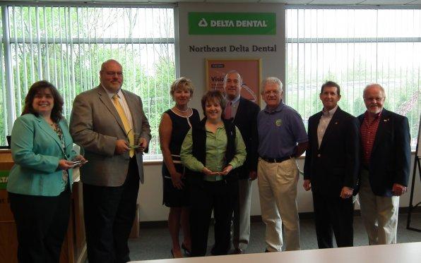 The winners of the Capital Area Wellness Coalition's Well Done! Awards say chees alongside Mayor Jim Bouley, Johane Telgener and Joe Kasper. Darn it, now we want some cheese.