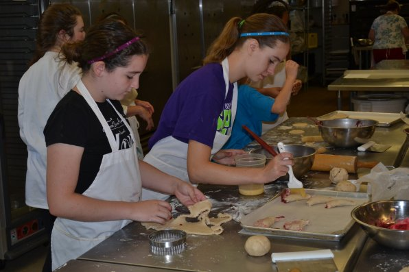 Keelin Cripps and Laura Gamelin put the finishing touches on their mixed berry tarts.