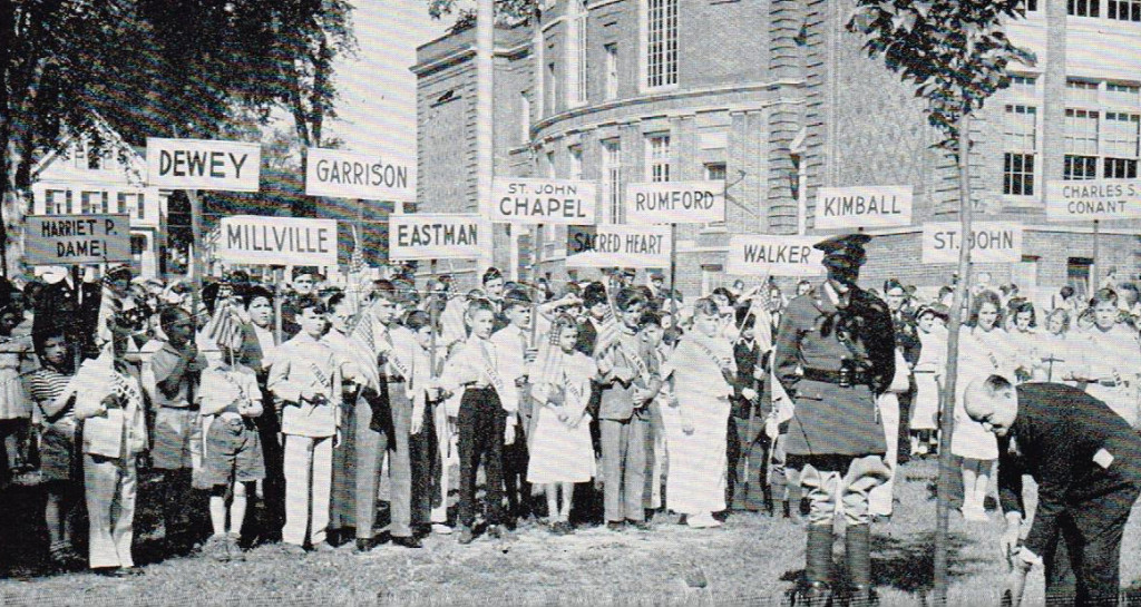 We thought this photo was from the days when child laborers were sent to airports with printed signs to pick up arriving dignitaries, but it turns out that was never a thing that happened. This photo is actually from June 21, 1938, during Concord's Sesquicentennial celebration of New Hampshire and the Federal Constitution. That's Gov. Francis Murphy at the right planting a tree at the Walker school as part of the opening ceremony, and that's a very rigid officer of the law directly in the tree's shadow. Thanks to reader Earl Burroughs for the pic.