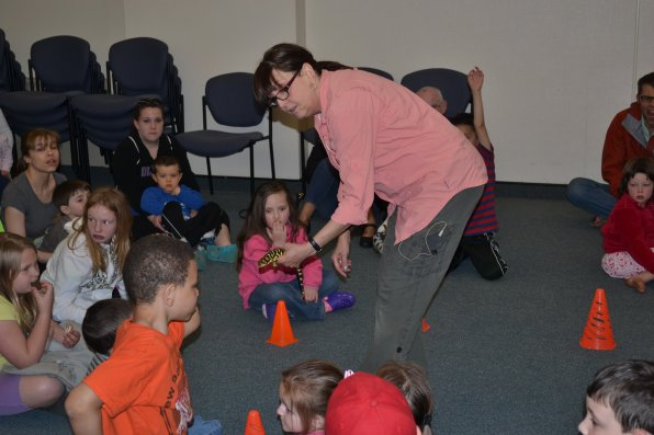 If you look real close, you can see Mona Headen showing Spot, a tiger salamander, to a bunch of very interested library goers as part of Headen's Critters 'N Creatures presentation.