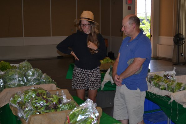 Ken Stuart gets a run down of what Local Harvest is all about from CSA whiz Sarah Hansen.