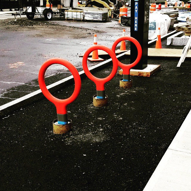 Um, construction guys, we hate to break it to you, but it looks like when you were putting in the gymnastics rings for when Concord hosts the 20-whatever summer Olympics thanks to its revitalized downtown, you put them in upside down. Also, nobody has three arms. Signed, management. That's a joke, of course (complete list of things that would be worse than having the Olympics in Concord: full-body poison ivy). These are actually the swanky new bike racks that are part of the Main Street redesign project. Pretty sweet, eh? It's what we like to call a Scwhinn Schwinn. (That was terrible, sorry.) Thanks to Instagram user @mcashion for taking the photo!