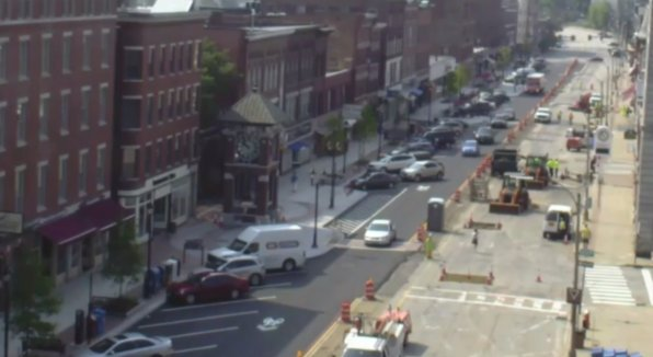 This image is a screenshot of the webcam on the Concord Main Street Project website (that should explain the fuzzies), and it clearly shows traffic moving north, and only north, on Main Street. That's life now, people. But all the pretty stuff you see on the left side of the photo will soon be on the right side, too. Huzzah!