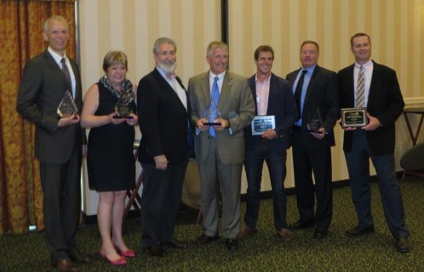 Check out the winners of the prestigious Concord Triangles of Glass trophy! Pictured with Byron Champlin, chairman of the Greater Concord Chamber of Commerce Board of Directors, are winners David K. Fries, Rosemary Heard, Ken Koornneef of Nobis Engineering, Charlie Cole, John Cimikoski and Ryan Taylor.