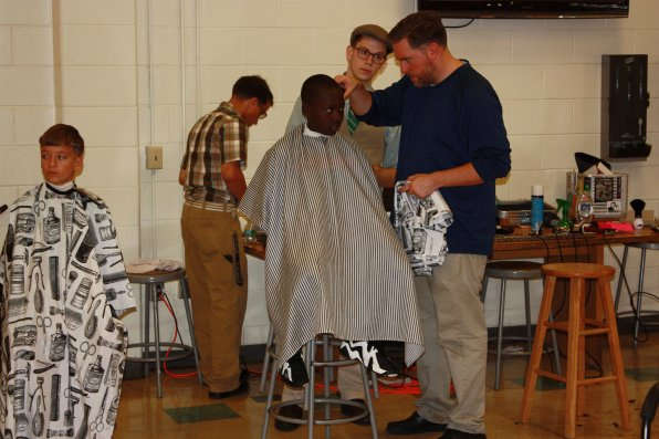Daniel Spooner (left) and Odeyi Kizumg, both 11, get some work done on their hair.