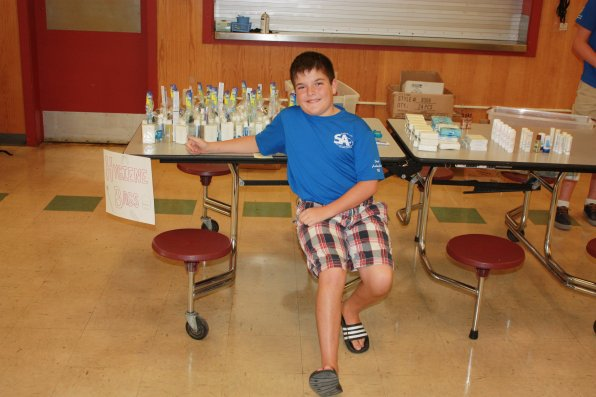 Brady Haywood-Minery, 12, mans the hygiene pack table.