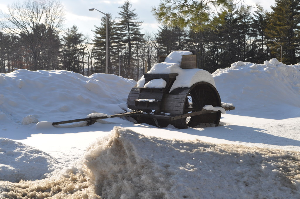 We were going to include this in our snowbank scavenger hunt a few weeks ago, but never got around to it. Still, that's a pretty cool whatever that is. We'd have hopped up there to take a ride around Concord, old-school style, but there's never a team of oxen around when you need it.