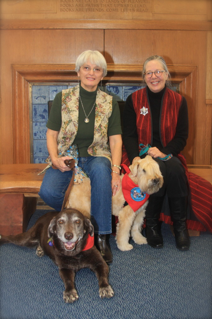 Janet Ulbrich, her dog Lily, Brenda Kern and her dog Sparkle received the 2012 Elizabeth Yates Award for their work with the Concord Public Library Paws for Pages program. The award is given annually to greater Concord residents actively engaged in encouraging young people to read.
