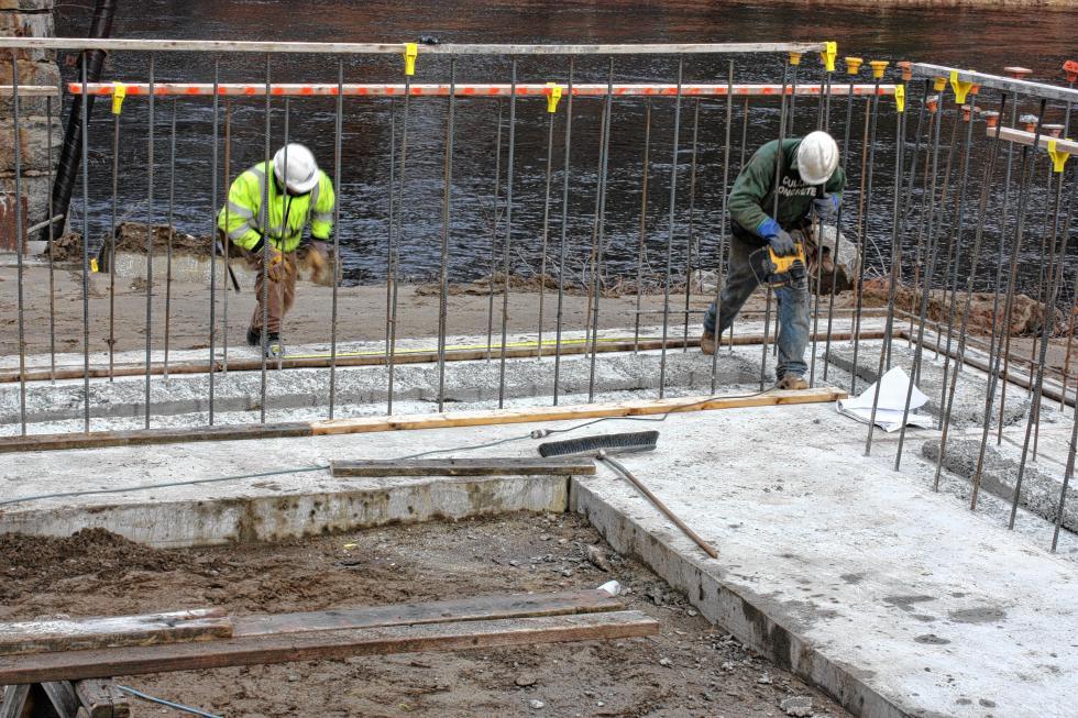 Chip Tibbetts (left) and Lon Collins of E.D. Swett do some form work for the new bridge. (JON BODELL / Insider staff) -
