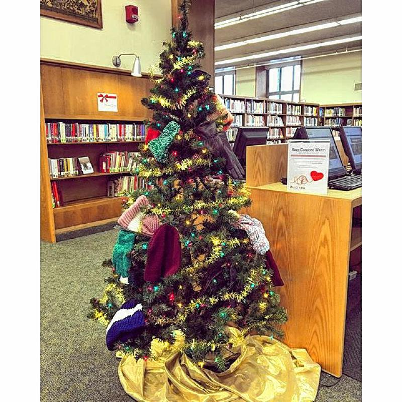 At first glance, this might just look like any ol' Christmas tree set up in a library. But upon further investigation of this @concordnhlibrary pic is that it's covered with hats, scarves and gloves. No, they didn't run out of ornaments when decorating, rather this tree was created as part of the initiative, Keep Concord Warm, where people are asked to donate new or newly homemade hats, gloves, mittens, socks or scarves through Dec. 15 – and you even get to put them right on the tree. Donations will go to the Concord Homeless Resource Center. (Courtesy photo) -