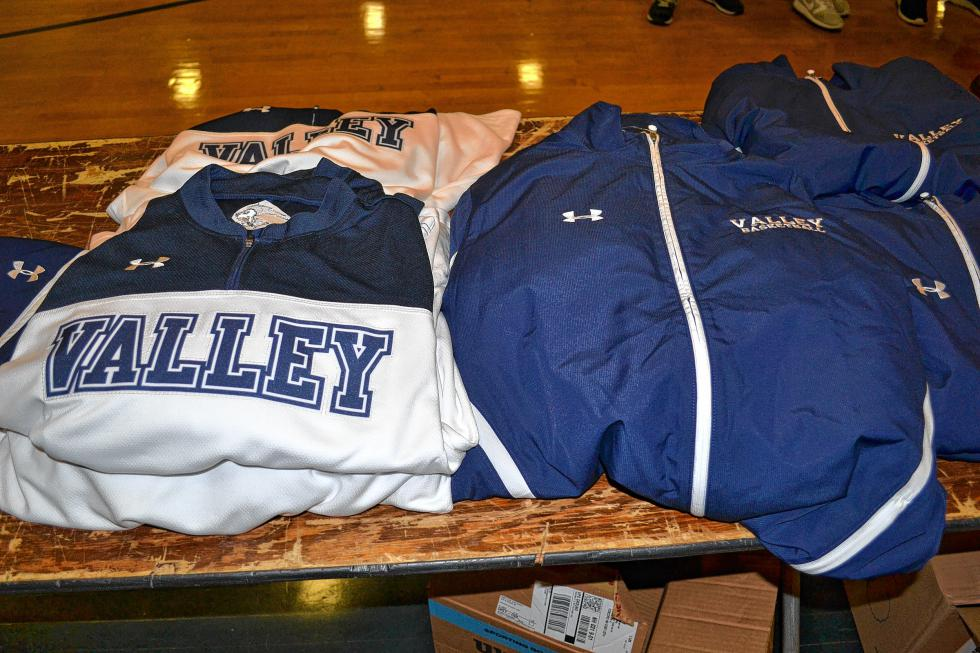 Not only did the Merrimack Valley varsity basketball programs get new home and away jerseys, but they also got warmup suits and shooting shirts. (TIM GOODWIN / Insider staff) -