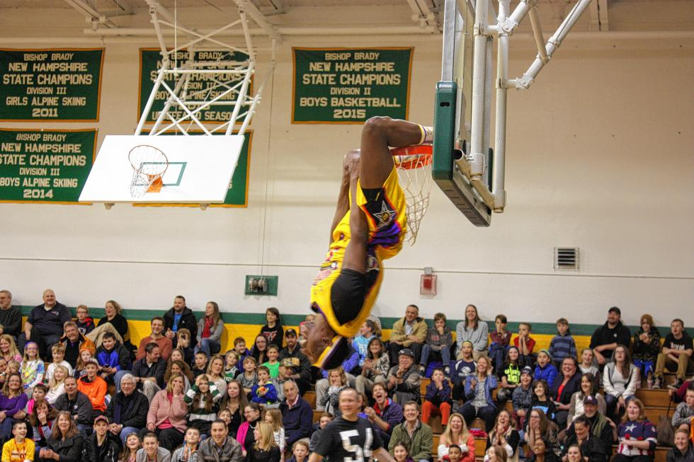 Big J hangs upside down after throwing down a monster dunk. (JON BODELL / Insider staff) -