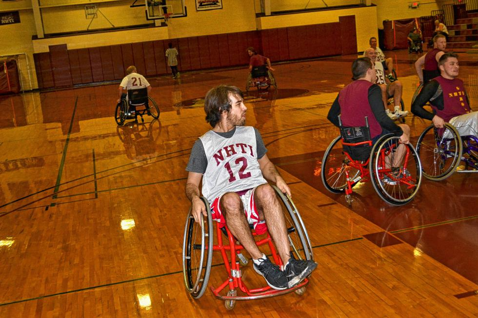 Jon does a little show-boating after scoring his second basket in the NHTI wheelchair basketball game. He doubled the scoring output Tim managed lsat year, just so you know. (TIM GOODWIN / Insider staff) -