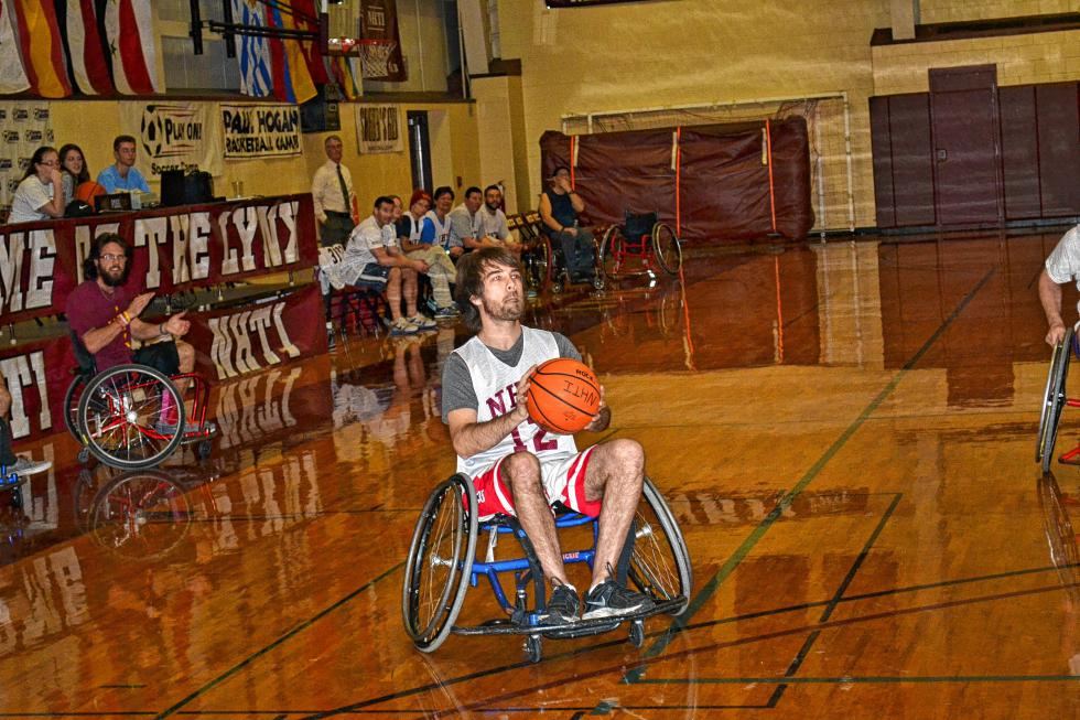 Jon sets up for a mid-range jumper during the NHTI wheelchair basketball game last week. Well, it wasn't exactly a jumper, but you get the idea. (TIM GOODWIN / Insider staff) -